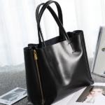 Женская кожаная сумка с молниями